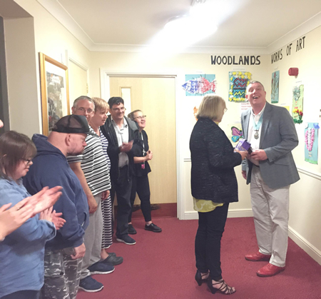 Deputy Mayor for Cambridge, Cllr. Nigel Gawthorpe, checks out the creative art projects produced by our young residents at Woodlands Court.